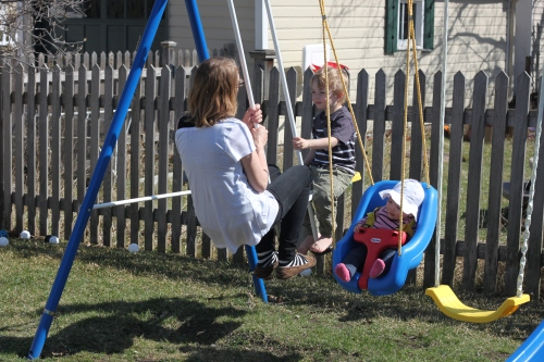 3:50 pm - more play outside on this beautiful april day, swinging with mamma and Fiona